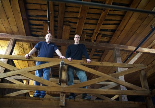 YORK, MAINE -- 02/03/16 -- David Woods (left) and his son David Woods II of Wiggly Bridge Distillery stand in the loft of the barn on Route 1 in York that will become their second location on Wednesday afternoon. The 19th century structure's last incarnation was as a hardware store. Troy R. Bennett | BDN