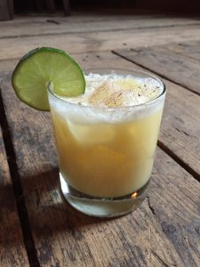 Painkiller, vacation in a glass, small barrel rum, white rum, orange juice, pineapple juice, cream of coconut, nutmeg, ice, lime