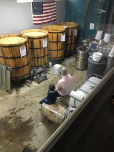 grandson, grandfather, family, distillery, barrels