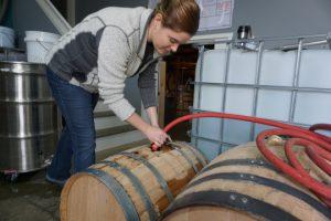 Quinn, filling barrels, bourbon